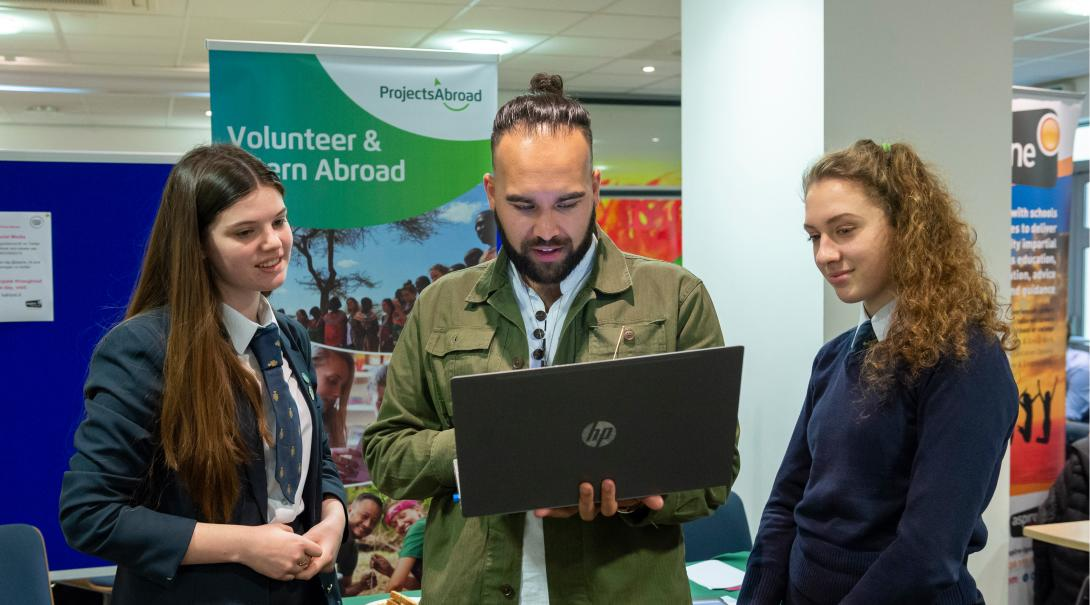 Projects Abroad staff talk to potential volunteers during an information event in the UK.